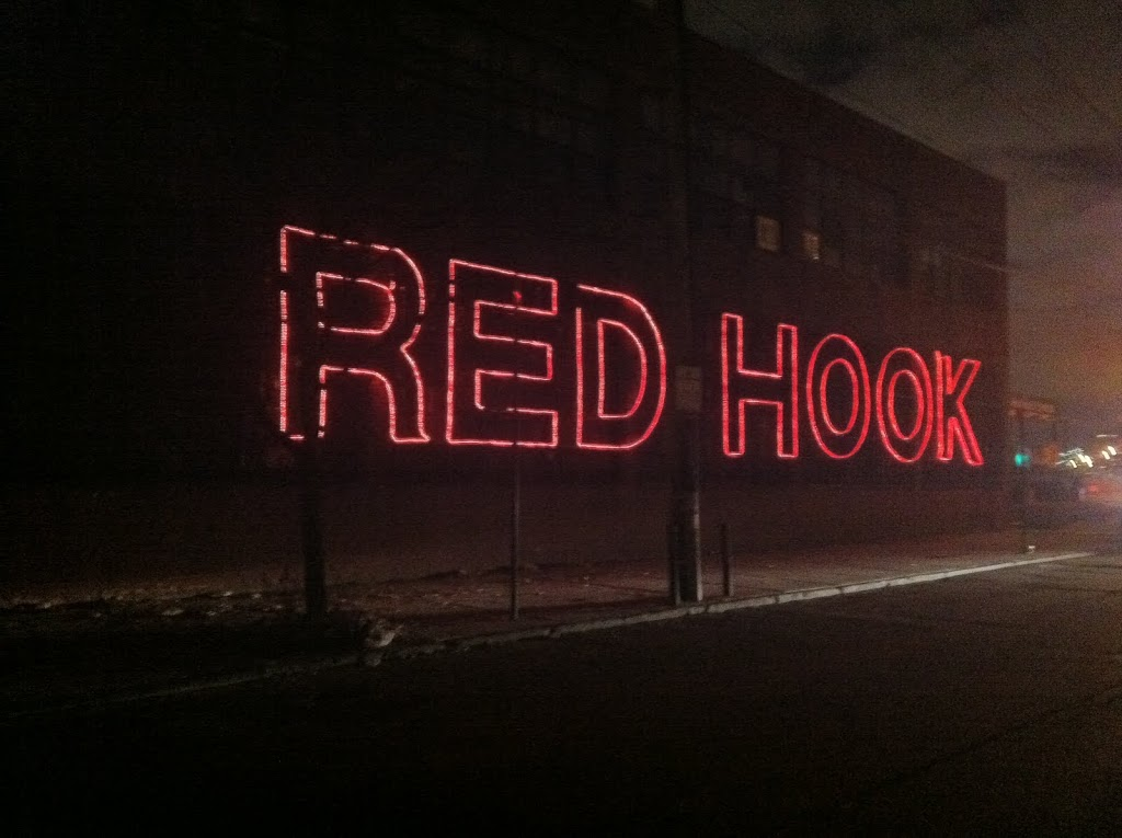"""red hook Red hook is an increasingly gentrified neighborhood that exists alongside active warehouses and a very large housing project, which is never a recipe for """"the."""