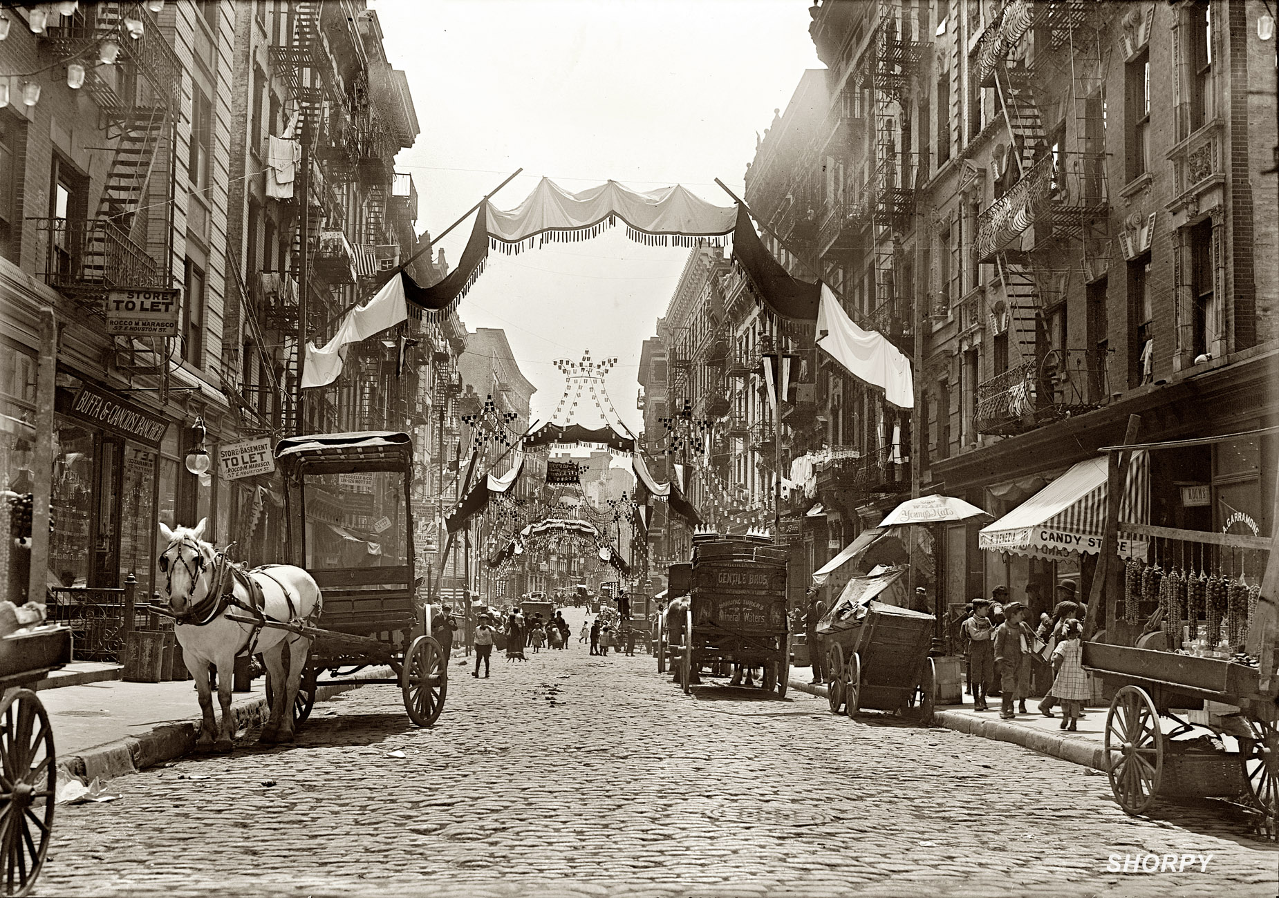 Mott Street all fancied up for a religious festival in 1908. It's May 16, so perhaps Ascension Day? (Cleaned up picture courtesy Shorpy)