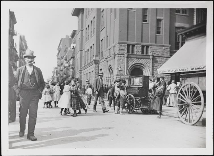 Children dancing on Mulberry Street as a man plays a barrel organ. (No monkey in sight!) 1897 (Courtesy Museum of the City of New York)