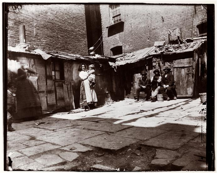 1897 Yard in Jersey Street (now gone). A woman holding a child, and men sitting in a rear yard of a Jersey Street tenement. Pietro lived on Jersey Street and one of these buildings may have been his home.