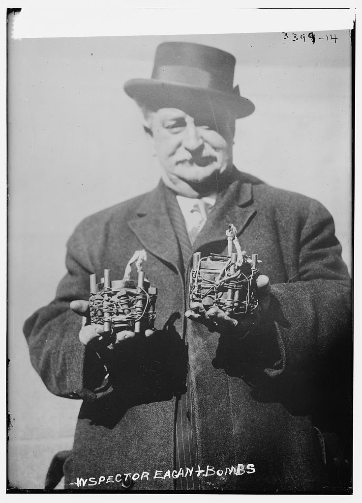 Owen Eagan (1957-1920), a bomb expert in the New York City Fire Department's Bureau of Combustibles. He is holding a bomb recovered from an attempted anarchist bombing of St. Patrick's Cathedral, New York City on March 2, 1915. (Source: Flickr Commons project and New York Times, March 3, 1915) Forms part of: George Grantham Bain Collection (Library of Congress).