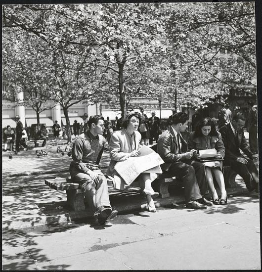 "This photo was taken by Stanley Kubrick during his years as a photographer for Look Magazine. The caption reads ""Park Bench Nuisance [Woman reading a newspaper, while a man reads over her shoulder.]"" Courtesy Museum of the City of New York"