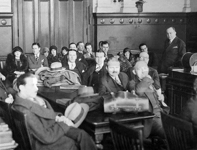 Original caption: Cast of  Tried By Jury.  New York, New York:  Photo shows scene in courtroom of general sessions part II at start of members of  company.  Mae West and Barry O'Niel, in productions leading roles, can be seen at extreme left. March 28, 1927 New York, New York, USA