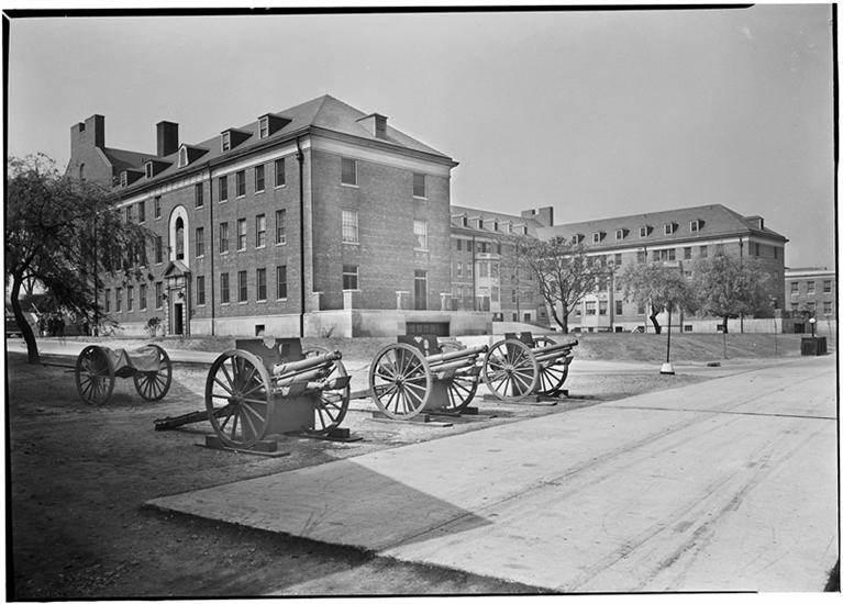 Photo by Samuel H. (Samuel Herman) Gottscho.  Officer's apartments, Governors Island, N.Y. 3/4 view cannon foreground. Courtesy Museum of the City of New York