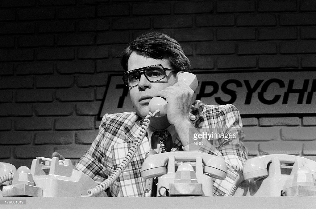 "SATURDAY NIGHT LIVE -- Episode 8 -- Pictured: Dan Aykroyd as Ray during the ""Telepsychic"" skit on December 9, 1978 -- (Photo by: NBC/NBCU Photo Bank)"