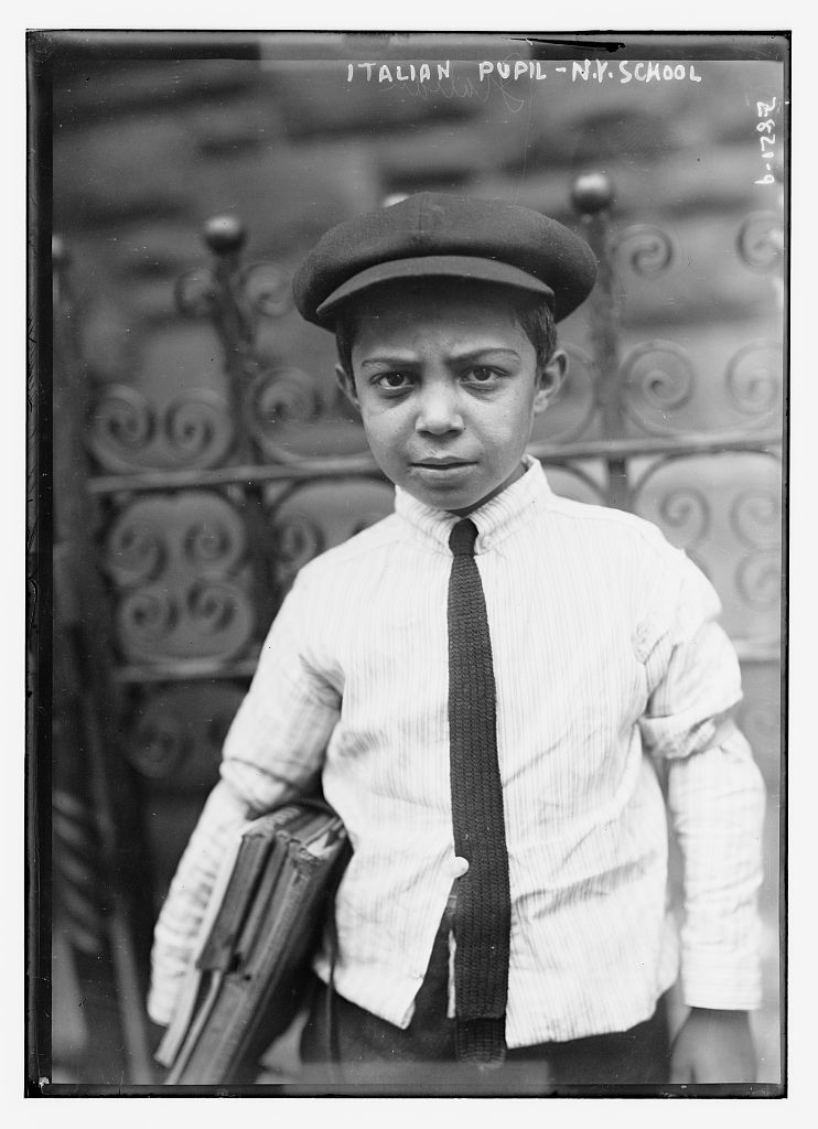 An Italian boy on his way to school in New York, taken between 1910 and 1915.