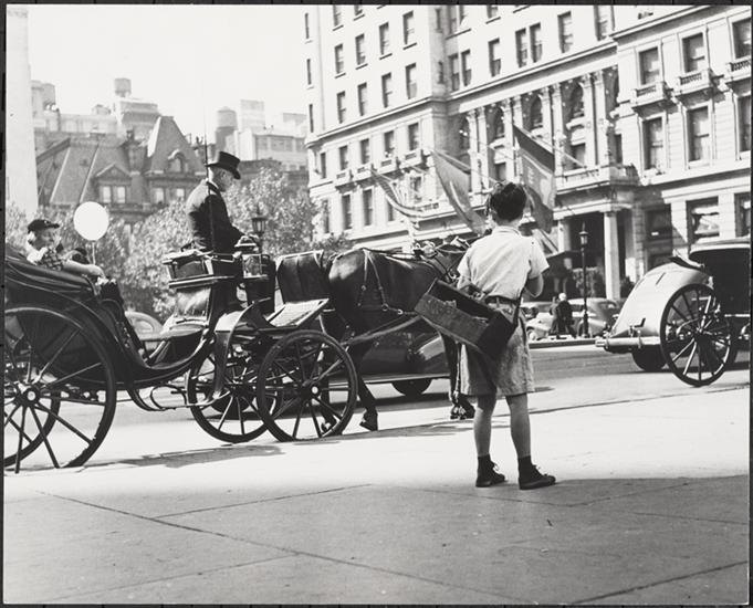This picture was taken in 1940. Except for the shoe-shine boy and the automobile, it could have been taken yesterday. (Photograph by Roy Perry, courtesy the Museum of the City of New York)
