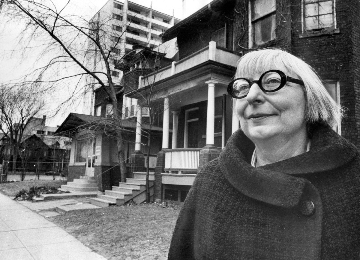"SCANNED FROM THE TORONTO STAR LIBRARY *U42 GRAPHIC Jane Jacobs outside her home on Spadina Road just north of Bloor Street. Photo taken by Frank Lennon/Toronto Star Dec. 21, 1968. Also published 19730425 with caption: Jane Jacobs. Urban affairs expert. Also published 19740520 with caption: Toronto's in good shape, says author Jane Jacobs, but ""We've got to be thinking about how we make sure it stays that way."" Just being Canadian gives it some advantage, she says, but she fears amalgamation will bring some of the problems of cities like New York."