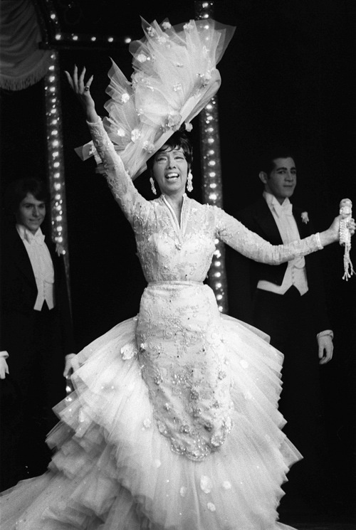 US-born dancer Josephine Baker, nicknamed Black Venus, performs 26 March 1975 at a Paris'stage Bobino, two weeks before her death 10 April 1975. Baker, born 03 June 1906 in St. Louis, Missouri, first danced for the public on the streets of St. Louis and in the Booker T. Washington Theater, a black vaudeville house in her native town. Later she became a chorus girl. Her first job in Paris was in La Revue Negre at Folies Bergeres in 1925, where she first performed her famous banana dance. In 1937 she renounced her American citizenship and became a citizen of France. During WWII, Josephine Baker worked as a spy for the French resistance and became sub-lieutenant in the Women's Auxiliary of the French Air Force. Baker was back in France in 1954, with the intention of raising a family o ethnically diverse children that she had brought to France from her tours around the world. In her last years, Baker suffered struggles, financial difficulties, and poor health. (Photo credit should read PIERRE GUILLAUD/AFP/Getty Images)