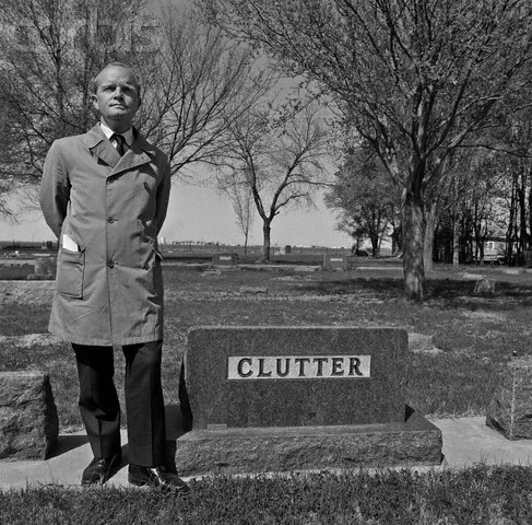 1967, Holcomb, Kansas, USA --- Author Truman Capote poses at the grave of the murdered Clutter family, made famous in his novel and in the film . --- Image by © Bob Adelman/Corbis